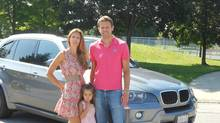 Tennis player Daniel Nestor, wife Natasa and daughter Tiana with his 2011 BMW X5.