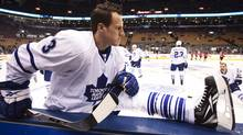 Toronto Maple Leafs' Dion Phaneuf stretches during warm ups before his team plays the New Jersey Devils during in their NHL hockey game in Toronto February 2, 2010. REUTERS/Mark Blinch (MARK BLINCH)