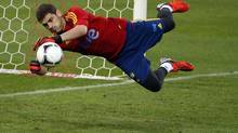Spain's captain and goalkeeper Iker Casillas makes a save during a training session at Vicente Calderon stadium in Madrid October 15, 2012. (Reuters)