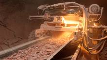 Potash drilled from the earth is carried up to the surface on a conveyor belt. (DAVID STOBBE)