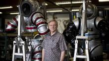 Phil Nuytten, President of Nuytco Research Ltd., is photographed with some of his atmospheric diving systems at Nuytco Research Ltd. in North Vancouver, British Columbia, Friday, July 10, 2015. (Rafal Gerszak/Rafal Gerszak)