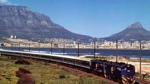 This undated publicity photo supplied by Transnet shows the Blue Train against a backdrop of Table Mountain in Cape Town, South Africa. On Monday, Bombardier said it was one of four companies to supply locomotives as part of a fleet-renewal program. (AP)
