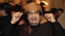 Libya's leader Muammar Gaddafi arrives to give television interviews at a hotel in Tripoli March 8, 2011 (AHMED JADALLAH/AHMED JADALLAH/REUTERS)