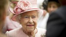 Queen Elizabeth II is pictured during a garden party at Hillsborough Castle in Northern Ireland on June 24, 2014. (LIAM McBURNEY/REUTERS)