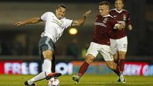 Manchester United's Zlatan Ibrahimovic in action with Northampton Town's Sam Hoskins on Sept. 21, 2016. (John Sibley/REUTERS)