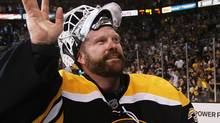 Tim Thomas #30 of the Boston Bruins celebrates after they defeated the Tampa Bay Lightning 1 to 0 in Game Seven of the Eastern Conference Finals during the 2011 NHL Stanley Cup Playoffs at TD Garden on May 27, 2011 in Boston, Massachusetts. (Photo by Elsa/Getty Images) (Elsa/2011 Getty Images)