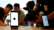 Members of the media film the new iPhone 7 at an Apple store in Beijing, China, September 16, 2016. (THOMAS PETER/REUTERS)