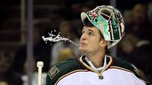 Matt Hackett of the Minnesota Wild spits out water during a game against the San Jose Sharks, Dec. 6, 2011 in San Jose, California. (Ezra Shaw/Ezra Shaw / Getty Images)