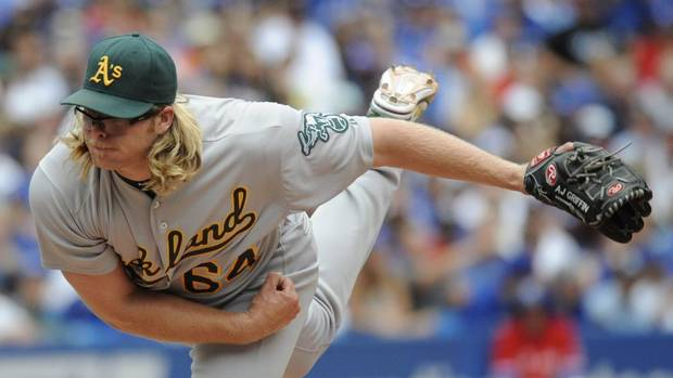 Oakland Athletics pitcher A.J. Griffin pitches against the Toronto Blue Jays during the third inning of AL baseball action in Toronto on Sunday, August 11, 2013. (Jon Blacker/THE CANADIAN PRESS)