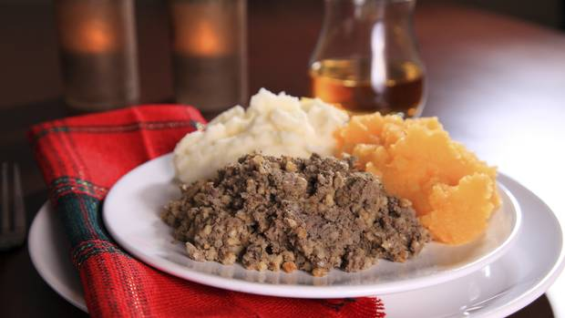 Scottish haggis with side dishes and a glass of scotch. (Norman Pogson/iStockphoto)