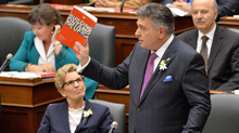 Ontario Finance Minister Charles Sousa delivers the provincial budget as Premier Kathleen Wynne looks on at Queen's Park in Toronto on Thursday, April 23, 2015. (Nathan Denette/THE CANADIAN PRESS)