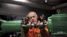 Alex Bernst, 63, works as a millwright and although he has reached his pension requirements and can retire at any time he chooses to continue to work. He is photographed on the job in Thunder Bay Dec. 20, 2012. (Moe Doiron/The Globe and Mail)
