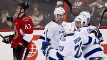 Ottawa Senators right wing Ales Hemsky skates past Tampa Bay Lightning defenseman Eric Brewer as he celebrates his goal during third period NHL action with teammates J.T. Brown (23), B.J. Crombeen (19) and Alex Killorn (17, hidden) Thursday March 20, 2014 in Ottawa. The Lightning defeated the Senators 5-4. (Adrian Wyld/THE CANADIAN PRESS)