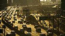 An average trip to and from work in Toronto takes 80 minutes, something the Federation of Canadian Municipalities wants the Harper government to fix with new commitments to cut commute times in Canada's cities. (Kevin Van Paassen/Kevin Van Paassen/The Globe and Mail)