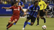 Toronto FC's Sebastian Giovinco, left, defends Impact midfielder Patrice Bernier during the first leg of the MLS Eastern Conference Championship at Olympic Stadium in Montreal on Nov. 22. (Eric Bolte/USA Today Sports)