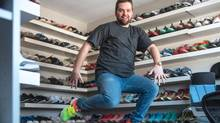 Among Andy Oliver's sneaker collection, which totals almost 600 pairs, are custom Nikes that he had made for his wedding day. Unlike other collectors he typically buys his shoes at retail prices – and actually wears them.