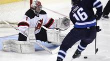 Winnipeg Jets' Andrew Ladd (16) scores on New Jersey Devils goaltender Johan Hedberg (1) at eight second mark of the first period NHL action in Winnipeg on Thursday, February 28, 2013. (JOHN WOODS/THE CANADIAN PRESS)
