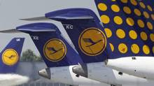 Lufthansa aircraft sit on the tarmac at Munich's airport on July 28, 2008. (MICHAELA REHLE/REUTERS)