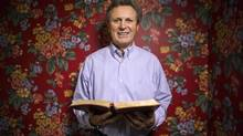 Former hockey player Paul Henderson clutches a bible at his home in Mississauga, Ont., on Wednesday, on December 3, 2014. Henderson, who is famous for leading Team Canada to victory over the Soviet Union in the 1972 Summit Series, is a born-again Christian and is currently battling cancer. Following his playing career he became a minister, motivational speaker and author. (Chris Young/THE CANADIAN PRESS)