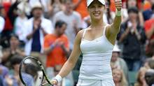 Eugenie Bouchard of Canada reacts after defeating Ana Ivanovic of Serbia in their women's singles tennis match at the Wimbledon Tennis Championships, in London June 26, 2013. (TOBY MELVILLE/REUTERS)