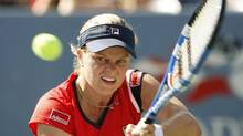 Kim Clijsters of Belgium hits a return to Marion Bartoli of France at the U.S. Open tennis tournament in New York on Sept. 2, 2009. (KEVIN LAMARQUE/REUTERS)
