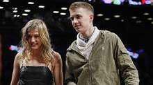 Genie Bouchard walks the court with her blind date, John Goehrke, during the first half of an NBA basketball game between the Brooklyn Nets and the Milwaukee Bucks on Feb. 15, 2017, in New York. (Frank Franklin II/AP)