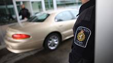 Canadian border agents at work on the Canadian border at the Peace Arch crossing in Surrey, B.C. (SIMON HAYTER FOR THE GLOBE AND MAIL)