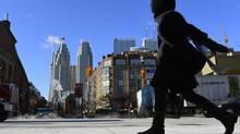 A woman walks in downtown Toronto on Wednesday, Jan. 7, 2015. (Frank Gunn/THE CANADIAN PRESS)