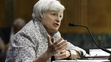 """Federal Reserve Chair Janet Yellen testifies on Capitol Hill in Washington, Tuesday, July 15, 2014, before the Senate Banking Committee. Ms. Yellen said stocks trading at 100-times earnings have """"stretched"""" valuations. (J. Scott Applewhite/AP)"""