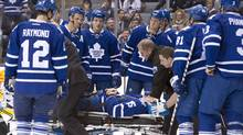 Toronto Maple Leafs' Paul Ranger is taken off the ice on a stretcher after hitting the boards head first from a check by Tampa Bay Lightning's Alex Killorn during first period NHL action in Toronto on Wednesday March 19, 2014. (CP)
