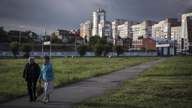 An elderly couple out for an evening stroll in Perm on June, 7, 2015.