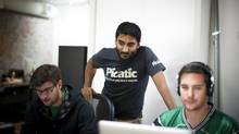 Jayesh Parmar, centre, is using crowdfunding to raise investment funds for his company, Picatic. It's approximately three-quarters of the way toward raising $750,000 on AngelList. (Rafal Gerszak For The Globe and Mail)