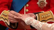 In this image taken from video, Britain's Prince William, left, places the ring on the finger of his bride, Kate Middleton, as they stand at the altar at Westminster Abbey for the Royal Wedding in London on Friday, April, 29, 2011. (AP Photo)