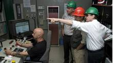 Robert Friedland (R), executive chairman of Ivanhoe Mines, points out a feature of the control room at the Oyu Tolgoi mine to Mongolian Prime Minister Sukhbaatariin Batbold (2nd R) and Keith Marshall (2nd L), president and CEO of Oyu Tolgoi LLC, September 7, 2010. Picture taken September 7, 2010. To match Special Report MONGOLIA-MINE/ REUTERS/Ivanhoe Mines/Handout (REUTERS/Ivanhoe Mines/Handout/REUTERS/Ivanhoe Mines/Handout)