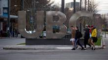 Young men walk past large letters spelling out UBC at the University of British Columbia in Vancouver on November 22, 2015. (Darryl Dyck/THE CANADIAN PRESS)