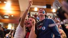 Students supporting U.S. President Barack Obama react as they watch election returns come in inside the Kennedy Forum at the Harvard University John F. Kennedy School of Government. (Scott Eisen/Bloomberg)
