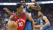 Toronto Raptors guard DeMar DeRozan drives past Minnesota Timberwolves guard Andrew Wiggins in Toronto on Feb. 24. (Nathan Denette/THE CANADIAN PRESS)