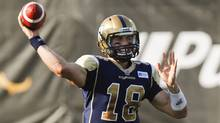Winnipeg Blue Bombers quarterback Justin Goltz makes a pass during first quarter CFL preseason action against the Hamilton Tiger-Cats in Guelph, Ontario Thursday, June 20, 2013. (Aaron Lynett/The Canadian Press)