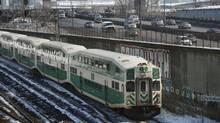 A GO Train heads west along the GO Transit/Metrolinx rail corridor. (Fred Lum/The Globe and Mail)