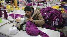 Employees work at a garment factory in Wuhu, Anhui province in this February 1, 2012 file photo. China's factory sector contracted for an eighth straight month in June 2012, with export orders and prices turning in their weakest showing since early 2009. (JIANAN YU/REUTERS)