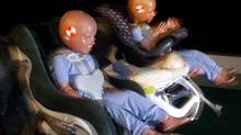 Crash dummies are restrained during the simulation of a 15-km an hour crash test by the Insurance Corporation of B. C. Friday Aug. 27,1999. (Chuck Stoody/ The Canadian Press/Chuck Stoody/ The Canadian Press)