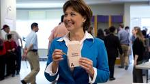 BC Liberal leader Christy Clark prepares to cast her ballot during advanced voting in Burnaby, B.C. Wednesday, May 8, 2013. (JONATHAN HAYWARD/THE CANADIAN PRESS)