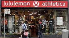 A woman leaves the Kitsilano, B.C. Lululemon store in Vancouver Thursday, October 18, 2007. (RICHARD LAM/The Canadian Press)