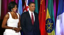Michelle Obama's knee-length number comes courtesy of Paris-based designer Azzedine Alaia. (Dave Chidley/Getty Images)