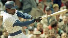 This is an April 4, 1989, file photo showing Chicago Cubs' Andre Dawson following through on a two-run homer during the fourth inning against the Philadelphia Phillies, at Wrigley Field in Chicago. The last time the Baseball Writers' Association of America failed to elect anyone to the Hall of Fame was 1996. It could happen again Wednesday, with Roberto Alomar the top first-year candidate on a ballot that includes holdovers Andre Dawson, Bert Blyleven, Lee Smith and Jack Morris. (AP Photo/Mark Elias, File) (Mark Elias/1989 AP)