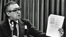 CBC President Pierre Juneau holds up a policy statement during a news conference in Ottawa, Oct.18, 1982. (Peter Bregg/Peter Bregg / CP)