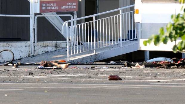 A body lies on the ground after the explosion, which killed six people and injured 32. (STRINGER/REUTERS)