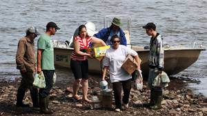Small boats carried food to the isolated, end-of-the-road community of Meat Cove, N.S., which was virtually inaccessible after the deluge.