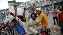 Supporters of the Pakistan Muslim League - Nawaz (PML-N) celebrate outside the party's election headquarters at the end of election day in Lahore May 11, 2013. (DAMIR SAGOLJ/REUTERS)