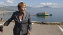 Parti Quebecois Leader Pauline Marois walks to a news conference on a wharf in Saint-Simeon, Que., on Wednesday, August 8, 2012. (Jacques Boissinot/THE CANADIAN PRESS)